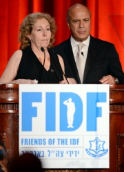 Mir Hadassi and Benny Shabtai address the FIDF dinner